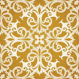 Vector seamless pattern with swirls and floral motifs in retro style. Golden Victorian background. It can be used for wallpaper, pattern fills, web page Royalty Free Stock Photo