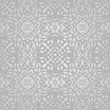 Vector seamless pattern with swirls and floral motifs in retro style. Royalty Free Stock Photo