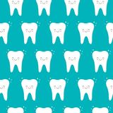 Vector seamless pattern with teeth on a blue background. Cute kawaii style royalty free illustration