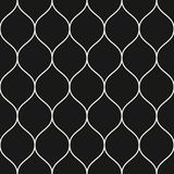 Vector seamless pattern, thin wavy lines. Black vertical mesh. Vector seamless pattern, thin vertical wavy lines. Texture of mesh, fishnet, lace, weaving Stock Photo