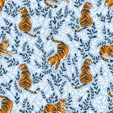 Vector seamless pattern with tigers isolated on the floral background. Animal background. Stock Image