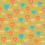 Vector seamless pattern with tulips and grass. Floral pattern. Orange and blue colors. Royalty Free Stock Photography