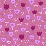 Vector seamless pattern with tulips and grass. Pastel background. Vector backdrop. Endless pattern. Royalty Free Stock Images