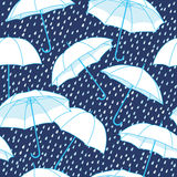 Vector seamless pattern with umbrellas Stock Images