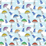 Vector seamless pattern with umbrellas flying at sailors. Stock Image