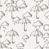 Vector seamless pattern with umbrellas in the rain Royalty Free Stock Image