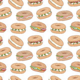 Vector seamless pattern with various fresh bagel sandwiches. Hand drawn various fresh bagel sandwiches vector seamless pattern. Bagels with cream cheese, lax Stock Photo
