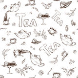 Vector seamless pattern on a white background sketch of items for the tea party. Teapot and cups, candy, lemon, saucer Royalty Free Stock Image