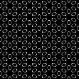 Vector seamless pattern, white figures on black. Vector seamless pattern, simple minimalist geometric monochrome texture, perforated white elliptic figures on Stock Photo