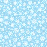 Seamless pattern with white snowflakes Royalty Free Stock Images