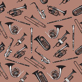 Vector seamless pattern with wind musical instruments. Stock Photos