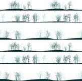 Vector seamless pattern with winter trees Stock Photos