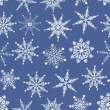 Vector seamless pattern. Winter wonderland delicate white snowflake crystal on blue background.. royalty free illustration