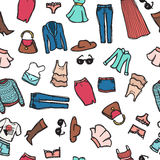 Vector seamless pattern with woman fashion objects. Clothes and accessories background in doodle style. Royalty Free Stock Photography