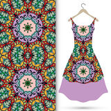 Vector seamless pattern and women's dress on a Royalty Free Stock Photography