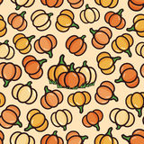 Vector seamless pattern with yellow and orange pumpkins Stock Photography
