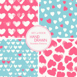 Vector seamless patterns with grunge colorful hearts Stock Images