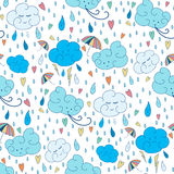 Vector seamless rain theme pattern. Colorful doodling autumn design with clouds. Royalty Free Stock Images