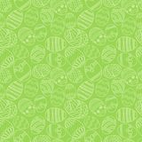 Vector seamless simple pattern with ornamental eggs. Easter holiday green background for printing on fabric, paper for Stock Photos