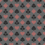 Vector seamless symmetrical pattern with black and red lined playing card symbols on the blue background. Royalty Free Stock Photography