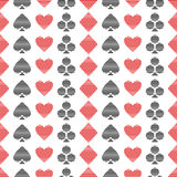 Vector seamless symmetrical pattern with black and red lined playing card symbols on the white background. Stock Photo