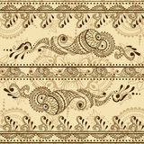Vector seamless texture with floral ornament in indian style. Mehndi ornamental striped pattern. Hand drawn ethnic design. Paisley elements for henna design Royalty Free Stock Photos