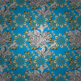 Vector seamless texture. Vector texture with golden floral doodles flowers on blue background with shadows Stock Photos