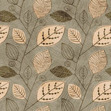 Vector seamless vintage pattern with silhouettes of leaves. Pattern of leaves Scandinavian style on a beige background. Eps-10 Royalty Free Stock Photo