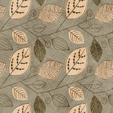 Vector seamless vintage pattern with silhouettes of leaves. Pattern of leaves Scandinavian style on a beige background. Eps-10 Stock Images