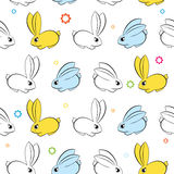 Vector seamless wallpaper. Easter bunnies on a white Stock Photo