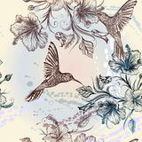 Vector seamless wallpaper pattern with birds and flowers. Seamless wallpaper pattern with hummingbirds and hibiscus flowers Stock Photo