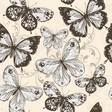 Vector seamless wallpaper with swirls and butterflies Stock Images