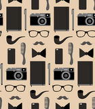 Vector seamlss pattern of content of hipsters bag with comb, notepad, mobile phone, camera, glasses etc. in flat style. Royalty Free Stock Photos