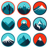 Vector set with abstract logos - mountains. Vector set with abstract logos and icons - mountains and summits in blue color Stock Illustration