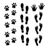 Vector set of black footprints of humans and animals. Vector illustration Stock Image