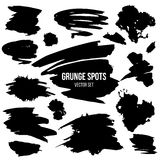 Vector set of black grunge spots Royalty Free Stock Photos
