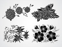 Vector set of black silhouettes flowers, branches and leaves. Royalty Free Stock Image