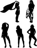 Vector set of black silhouettes of girls in various poses, standing at full height on a white background Stock Photos