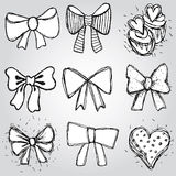 Vector set of bows, hearts, cupcakes sketch contour pen black and white Royalty Free Stock Photos