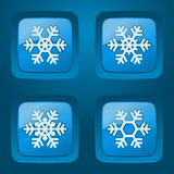 Vector set of buttons. Vector set of glossy buttons with snowflakes on dark background Royalty Free Stock Photos