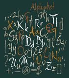 Vector set of calligraphic acrylic or ink alphabet. Dark background. Royalty Free Stock Photo