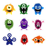 Vector set of cartoon cute monsters and aliens. Different funny creatures wityh big eyes and smiles Royalty Free Stock Image
