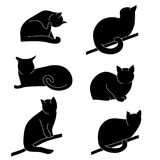 Vector set of cat silhouettes. Different postures: sitting, lying, resting, playing, hunting. Cat licking his paw, sits on a tree branch, cat is angry stock illustration
