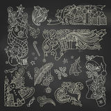 Vector set of chalk Christmas ornaments on blackboard background. Royalty Free Stock Photography