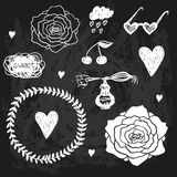 Vector set of chalk doodles on chalkboard Stock Images