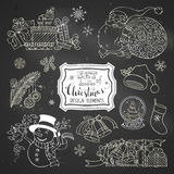 Vector set of chalk doodles Christmas design elements on blackboard background. Royalty Free Stock Image