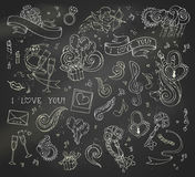 Vector set of chalk love doodles icons on blackboard background. Royalty Free Stock Photography