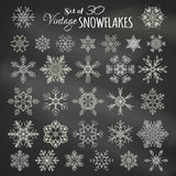 Vector Set of 30 Chalk Snowflakes. Hand-drawn chalk snowflakes on blackboard background Royalty Free Stock Image