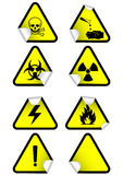 Vector set of chemical warning signs on stickers. Vector illustration set of different hazmat warning signs on peeled corners. All  objects and details are Royalty Free Stock Photos