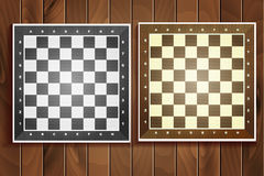 Vector set of chess boards on wooden background Stock Images
